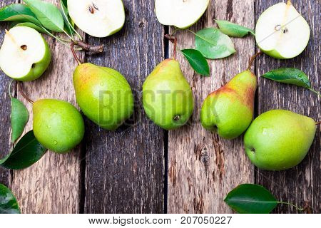 Pear On Wooden Rustic Background. Top View. Frame. Autumn Harvest. Copy Space.