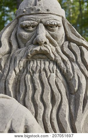 Viking head detail making with sand. Scandinavian culture. Vertical