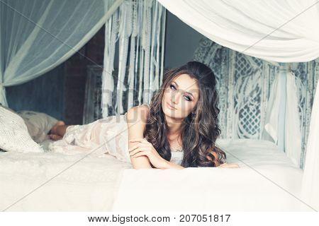 Perfect Woman Resting in Romantic Interior. Fashion Portrait of Cute Model