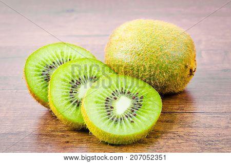 The Fresh kiwi fruit on wooden background.