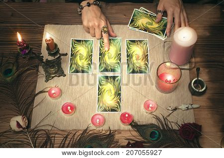 Fortune teller woman reading future with tarot cards.