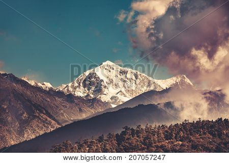 Himalayas mountain landscape. Trekking in Nepal. Magnificent views of the mountain range peak in clouds. Picturesque and gorgeous scene. Holiday, travel, sport, recreation. Retro vintage toning effect