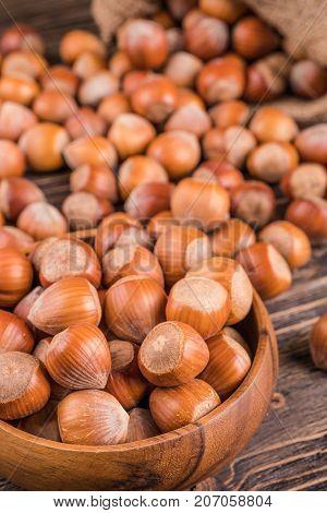 hazelnuts nuts in bag on wooden backgroun
