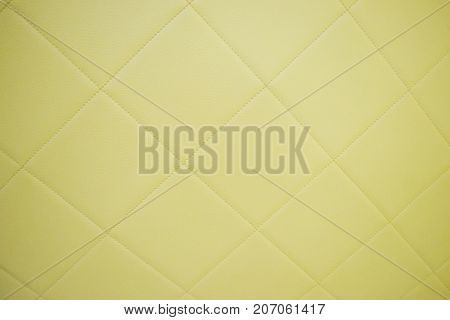 Surface of yellow leatherette texture for background and empty space for text .