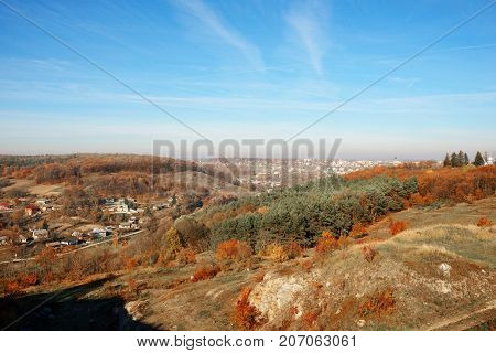 View On The Beautiful Colorful Autumn Landscape Of The Hills With Trees And Greenfields In The Count