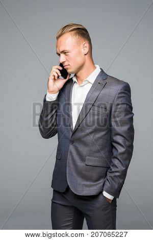 Manager, Man Or Businessman Talking On Smartphone Or Mobile Phone In Stylish Suit On Grey Background