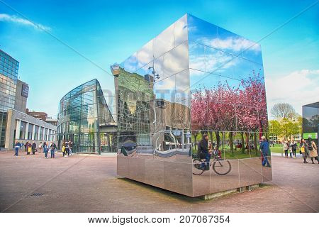 AMSTERDAM, NETHERLANDS - MAY 4, 2016: Cityscape with mirror cube near Van Gogh Museum, Amsterdam, Netherlands.