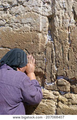 Woman desperate crying at the Wailing Wall.