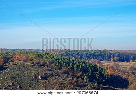 View On The Beautiful Colorful Autumn Landscape Of The Hills And Greenfields With Trees And Grass Up