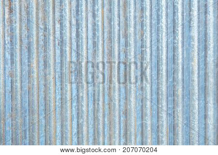 Rusty zinc corrugated iron metal siding for vintage background textured.