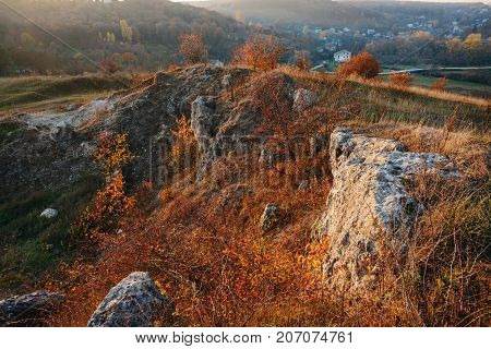 View On The Beautiful Colorful Autumn Landscape Of The Hills With Trees, Rocks And Greenfields In Th
