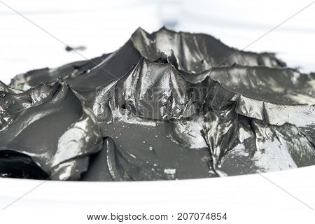 close-up of black grease for mechinery lubrication