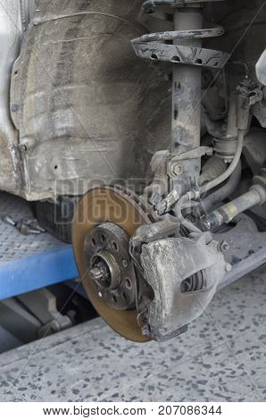 View of braking system and shock absorbers of a car
