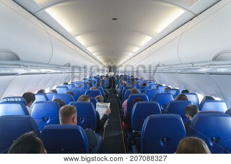 Moscow Russian Federation - March 16 2017: Interior of airplane with passengers on seats.
