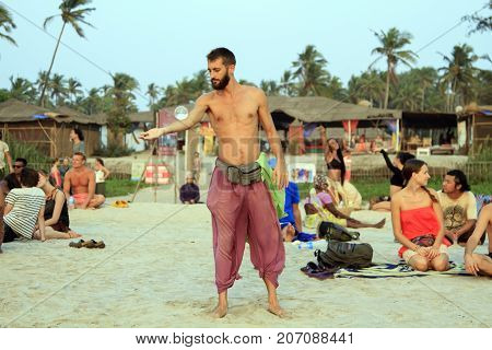 Goa India - February 15 2016: Unidentified man juggling with glass ball on the beach