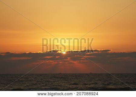 Evening scene with sunset on the sea