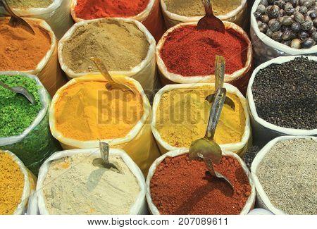 Assortment of powder color spices close up