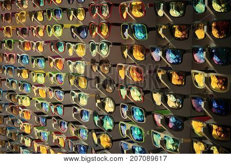 Many different color sun glasses at the sale