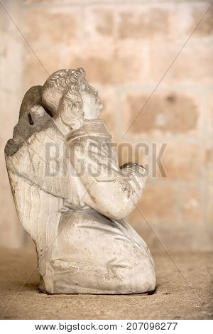 MONTMAJOUR FRANCE - JUNE 26 2017: Statue of angel in the cloisters of the Abbey of Montmajour near Arles France