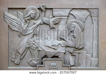 VARAZDIN, CROATIA - JULY 09: The Annunciation of Mary, detail of the entrance door of cahedral of Assumption in Varazdin, Croatia on July 09, 2016.