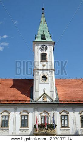 VARAZDIN, CROATIA - JULY 09: Varazdin city hall with clock tower, one of the most famous landmark in town, Varazdin, Croatia on July 09, 2016.