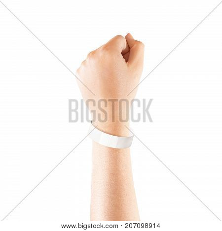 Blank white paper wristband mock up on persons arm. Empty event wrist band design mockup on hand. Cheap bracelets template, isolated. Clear adhesive bangle wristlet with sticker. Concert armlet