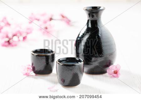 Prepared To Drink Sake On White Table
