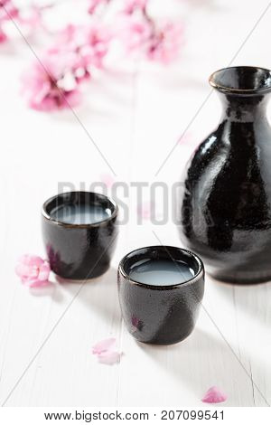 Unfiltered White Sake Sake With Flowers Of Blooming Cherry