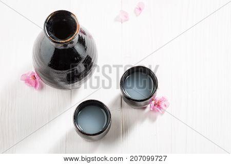 Traditional And Delicate Sake In Old Black Ceramics