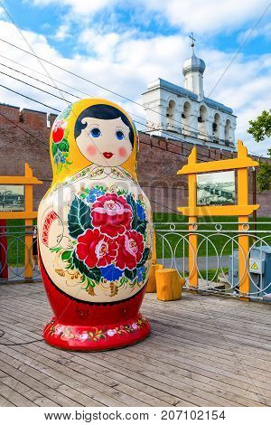 Veliky Novgorod Russia - September 15 2017: Big wooden matryoshka doll also known as a Russian nesting doll near the Novgorod Kremlin Russia