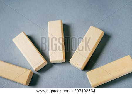 wooden rectangles on a gray background, close-up