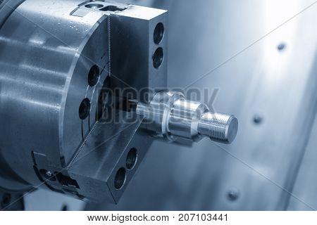CNC lathe machine (Turning machine) cutting the metal screw thread part by lathe cutter .Hi technology CNC machining concept.