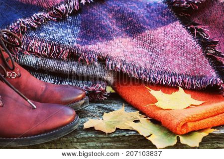 Fall Fashion Woman Clothes Set. Design.Trendy Cozy Sweater. Fashion Stylish Glamour Shoes. Yellow Fall Leaves on wooden background.