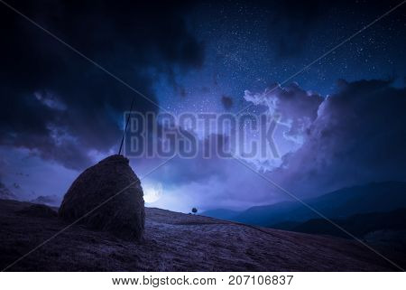 Moonrise With Clouds In A Night Starry Sky