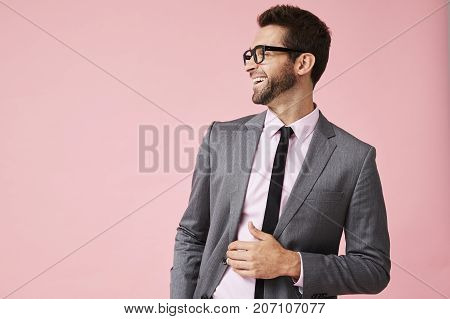 Laughing guy in business suit looking away