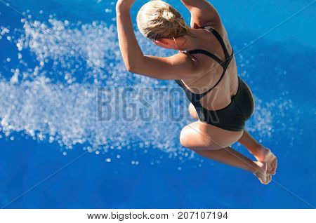Jumping To The Water, Blue Background, Selective Focus, One Person Only