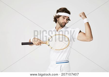 Smug tennis player with tennis ball muscle portrait
