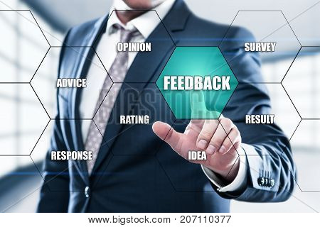 Feedback Business Quality Opinion Service concept on the hexagons and transparent honeycomb structure presentation screen. Man pressing button on display with word in modern office