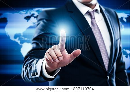 Business Technology Internet Network Concept. Businessman choose free empty space for text on world map background. Man presses virtual button. Manager click on futuristic touch screen.