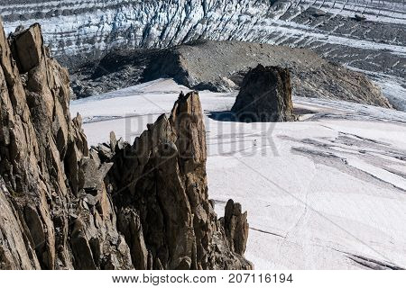 Lone Rock Climber On Top Of Pinnacle Overlooking Glacier