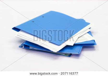 Blurred file folder with documents and documents. retention of contracts.