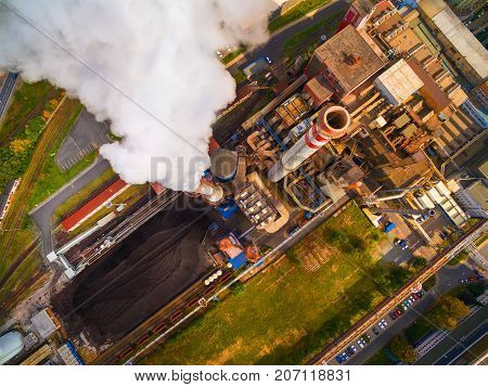 Aerial view of modern combined heat and power plant. Fuming chimney with sulphur removal unit. Heavy industry from above. Power and fuel generation in European Union.