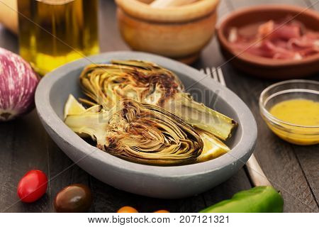 Artichokes in the bowl. Artichokes have one of the highest antioxidant capacities reported for vegetables and potentially lower cholesterol levels.