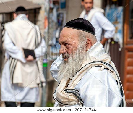 Hasids pilgrims in traditional clothes. Tallith - jewish prayer shawl. Uman Ukraine - September 21 2017: Rosh-ha-Shana festival Jewish New Year.