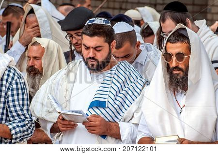 Mass prayer. Hasids pilgrims in traditional clothes. Tallith - jewish prayer shawl. Uman Ukraine - 21 September 2017: Rosh Hashanah Jewish New Year.