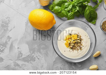Glass bowl with ingredients for fish taco sauce on kitchen table