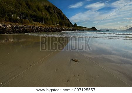 Sea landscape with mountains and sand shore Lofotens Norway