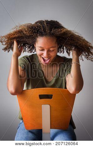 Portrait of teenage girl having fun in photo studio session
