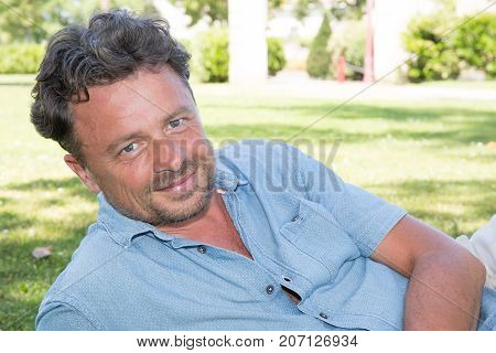 Cheerful Man Forties Lying In Vacation In Home Garden Summer