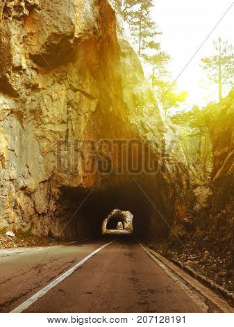 Road Through The Tunnels In The Mountains At Sunset